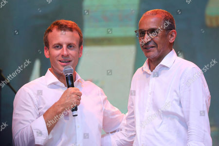 In this picture taken on French President Emmanuel Macron, left, is on stage with Mauritanian film director Abderrahmane Sissako during a live show at the New Afrika Shrine in Lagos, Nigeria. Macron has arrived in Nigeria in his latest attempt to forge closer ties with English-speaking Africa