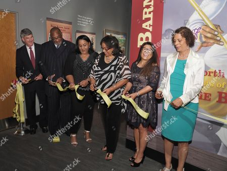 """This, photo made available by the North Carolina Museum of History shows family members of the late Ernie Barnes at a ribbon cutting ceremony for the """"The North Carolina Roots of Artist Ernie Barnes"""" exhibit at the museum, in Raleigh, N.C. From left to right: Ken Howard, museum director; Ernie Barnes' son Michael Barnes; his daughters Paige Barnes and DD Barnes; Luz Rodriguez, his personal assistant and trustee, and his wife, Bernadine """"Bernie"""" Barnes"""
