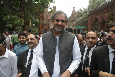 Pakistan's former Prime Minister Shahid Khaqan Abbasi, center, leaves a court in Lahore, Pakistan, . Abbasi who is facing disqualification from running in the July elections for concealing assets is allowed by the High Court to contest general elections from his home constituency
