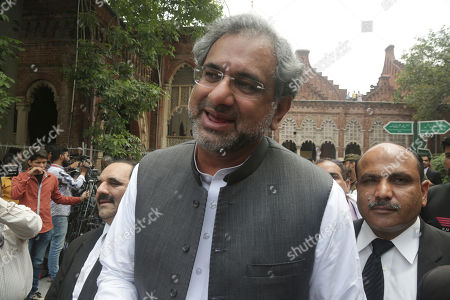 Shahid Khaqan Abbasi, Nawaz Sharif. Pakistan's former Prime Minister Shahid Khaqan Abbasi gestures as he leaves a court in Lahore, Pakistan, . Abbasi who is facing disqualification from running in the July elections for concealing assets is allowed by the High Court to contest general elections from his home constituency