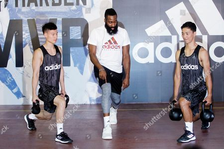 James Harden, center, gives instructions during a media event in Taipei, Taiwan