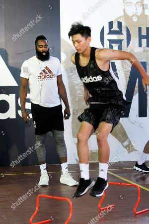 James Harden, left, gives instructions during a media event in Taipei, Taiwan