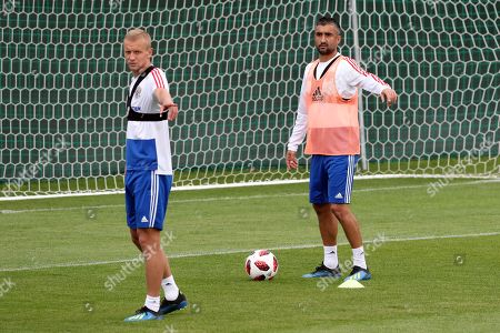 Russian players Aleksandr Samedov (r) and Igor Smolnikov (L) during a training session held in Federal Sports Centre Novogorsk, Novogorsk, Russian Federation, 04 July 2018.  Russia will face Croatia on 07 July in a quarter final match of the FIFA World Cup 2018.