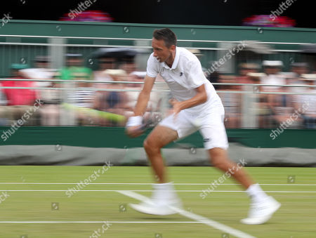 Sergiy Stakhovsky of Ukraine returns to Sam Querrey of USA in their second round match during the Wimbledon Championships at the All England Lawn Tennis Club, in London, Britain, 04 July 2018.