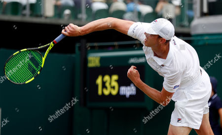 Sam Querrey of USA serves to Sergiy Stakhovsky of Ukraine in their second round match during the Wimbledon Championships at the All England Lawn Tennis Club, in London, Britain, 04 July 2018.