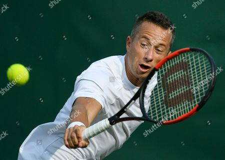 Philipp Kohlschreiber of Germany returns to Gilles Muller of Luxembourg during their third round match during the Wimbledon Championships at the All England Lawn Tennis Club, in London, Britain, 04 July 2018.