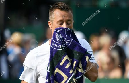 Philipp Kohlschreiber of Germany reacts during his third round match against Gilles Muller of Luxembourg during the Wimbledon Championships at the All England Lawn Tennis Club, in London, Britain, 04 July 2018.