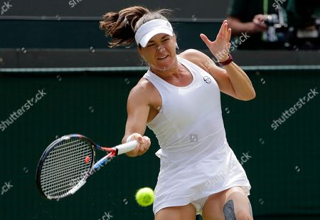 Alexandra Dulgheru of Romania returns the ball to Venus Williams of the US during their women's singles match on the third day at the Wimbledon Tennis Championships in London