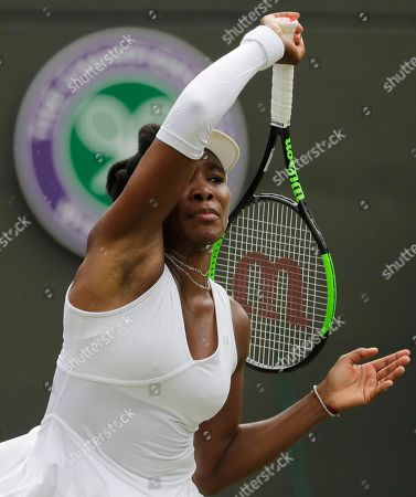 Venus Williams of the US returns a ball to Alexandra Dulgheru of Romania during their women's singles match on the third day at the Wimbledon Tennis Championships in London