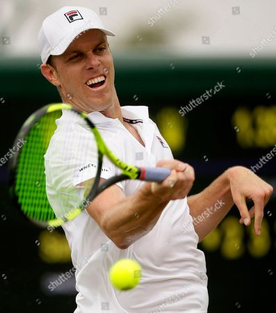 Sam Querrey of the US returns the ball to Sergiy Stakhovsky of Ukraine during their men's singles match on the third day at the Wimbledon Tennis Championships in London