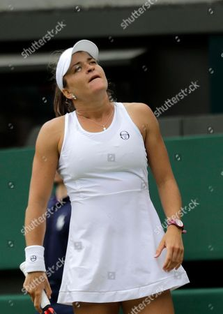 Alexandra Dulgheru of Romania looks up after losing a point to Venus Williams of the US during their women's singles match on the third day at the Wimbledon Tennis Championships in London