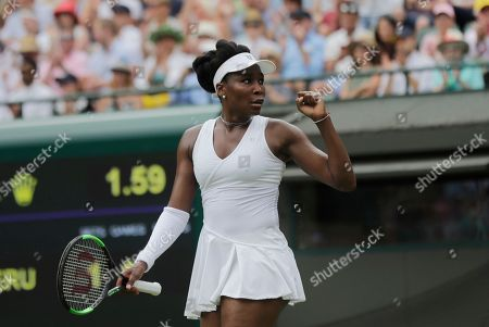 Venus Williams of the US celebrates defeating Alexandra Dulgheru of Romania in their women's singles match on the third day at the Wimbledon Tennis Championships in London