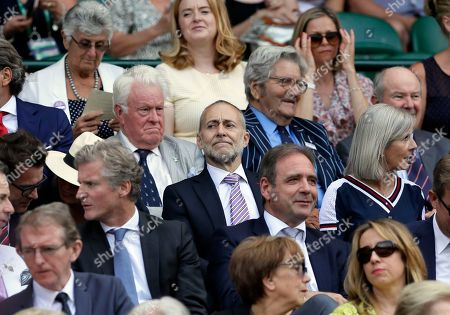 Michel Roux Jr, center, sits in the Royal Box on Centre Court on the third day at the Wimbledon Tennis Championships in London