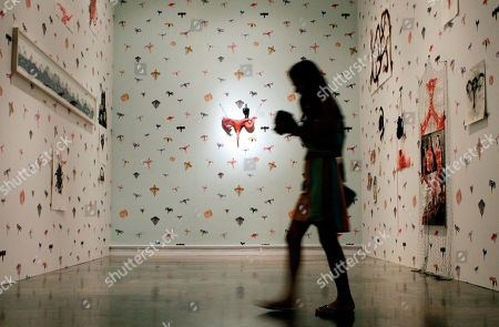 Stock Image of A woman visits an exhibition of French artist Annette Messager at the Valencia Institute of Modern Arts (IVAM) in Valencia, Spain, 04 July 2018. The exhibition titled 'Annette Messager. Pudique - Publique' will open to public from 05 July to 04 November 2018.