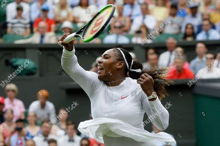 Serena Williams of the United States returns the ball to Bulgaria's Viktoriya Tomova during their women's singles match, on the third day of the Wimbledon Tennis Championships in London