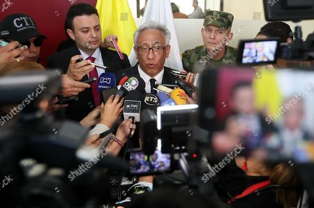 The director of the Institute of Legal Medicine of Colombia, Carlos Valdes (C), speaks during a press conference in Pasto, Colombia, 04 July 2018. Valdés confirmed that the two bodies found in a grave in the department of Narino (south) belong to the Ecuadorian couple kidnapped in the border province of Esmeraldas. 'The identity of the young Katty Velasco Pinargote and Oscar Villacis Gomez is fully confirmed with the support of the Technical Investigation Body, the identity is confirmed by dactyloscopy,' Valdés told reporters.