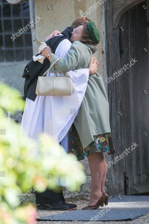 Actress Tessa Peake-Jones filming her last scene with James Norton in the village of Grantchester near Cambridge