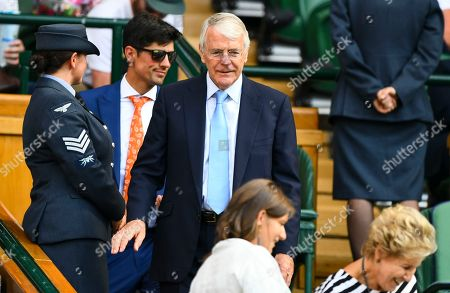John Major and Alistair Cook make their way to their seat in the Royal Box