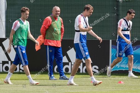 Stanislav Cherchesov, Alan Dzagoev, Aleksei Miranchuk, Artem Dzyuba. From left: Russia's Aleksei Miranchuk, head coach Stanislav Cherchesov, Artem Dzyuba and Alan Dzagoev attend a training session at the 2018 soccer World Cup, at the Federal Sports Centre Novogorsk, near Moscow, Russia