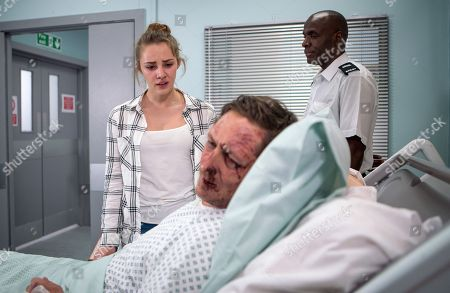 Ep 9504 Wednesday 9 July 2018 - 1st Ep An upset Kayla, as played by Mollie Winnard, as played by its at Neil's, as played by Ben Cartwright, hospital bed after he was beaten up by another inmate in prison.