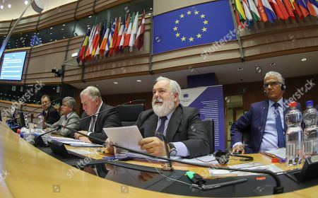 (L-R) European Committee of the Regions'  President Belgium's Karl-Heinz Lambertz, European Commissioner for climate action and energy Miguel Arias Canete and Mayor of German city of Bonn Ashok-Alexander Sridharan during European Committee of the Regions' 130th Plenary Session in the plenary room of the parliament in Brussels, 05 July 2018. The members debate on Climate Change with the European commission and experts.