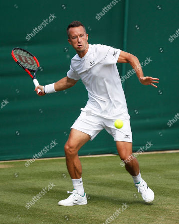 Philipp Kohlschreiber of Germany returns to Gilles Muller of Luxembourg in their second round match during the Wimbledon Championships at the All England Lawn Tennis Club, in London, Britain, 05 July 2018.