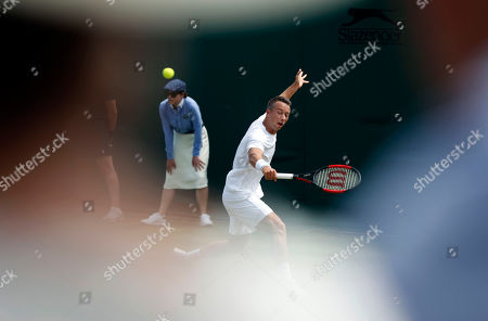 Stock Image of Philipp Kohlschreiber of Germany returns to Gilles Muller of Luxembourg in their second round match during the Wimbledon Championships at the All England Lawn Tennis Club, in London, Britain, 05 July 2018.