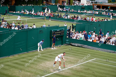 Philipp Kohlschreiber of Germany serves to Gilles Muller of Luxembourg in their second round match during the Wimbledon Championships at the All England Lawn Tennis Club, in London, Britain, 05 July 2018.
