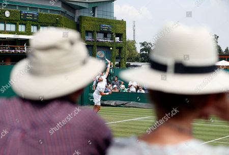 Stock Photo of Gilles Muller of Luxembourg serves to Philipp Kohlschreiber of Germany in their second round match during the Wimbledon Championships at the All England Lawn Tennis Club, in London, Britain, 05 July 2018.