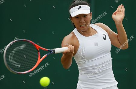 Claire Liu of the US returns the ball to Angelique Kerber of Germany during their women's singles match on the fourth day at the Wimbledon Tennis Championships in London