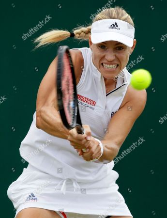 Angelique Kerber of Germany plays a return to Claire Liu of the US during their women's singles match on the fourth day at the Wimbledon Tennis Championships in London