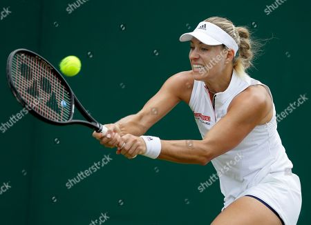 Angelique Kerber of Germany returns the ball to Claire Liu of the US during their women's singles match on the fourth day at the Wimbledon Tennis Championships in London