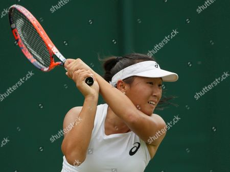 Claire Liu of the US plays a return to Angelique Kerber of Germany during their women's singles match on the fourth day at the Wimbledon Tennis Championships in London