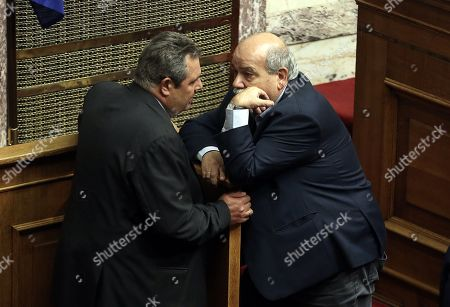 The President of ANEL party and Minister of National Defense Panos Kammenos (L) and the House Speaker Nikos Voutsis (R) attend a debate in the parliament on the economy and the results of the last Eurogroup, in Athens, Greece, 05 July 2018.