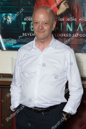 David Barron poses for photographers upon arrival at the UK premiere of Terminal in central London
