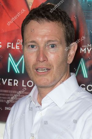 Nick Moran poses for photographers upon arrival at the UK premiere of Terminal in central London