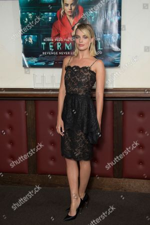Stock Image of Margot Robbie poses for photographers upon arrival at the UK premiere of Terminal in central London