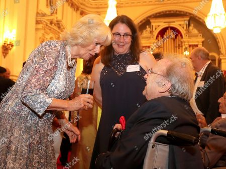 Stock Picture of Camilla Duchess of Cornwall meets Ronald Harwood, as she attends a reception celebrating the 50th anniversary of the Man Booker Prize at Buckingham Palace