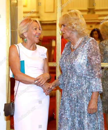 Camilla Duchess of Cornwall meets Dotti Irving, Chief Executive of Colman Getty, as she attends a reception celebrating the 50th anniversary of the Man Booker Prize at Buckingham Palace