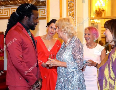Camilla Duchess of Cornwall meets winner Marlon James, as she attends a reception celebrating the 50th anniversary of the Man Booker Prize at Buckingham Palace