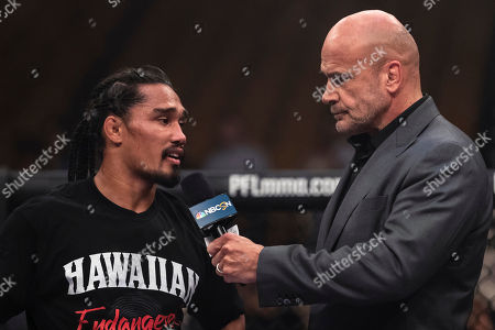 Bas Rutten interviews Ray Cooper III after the welterweight fight against Jake Shields at the Charles E. Smith Center at George Washington University in Washington, District of Columbia. Cooper defeated Shields by TKO