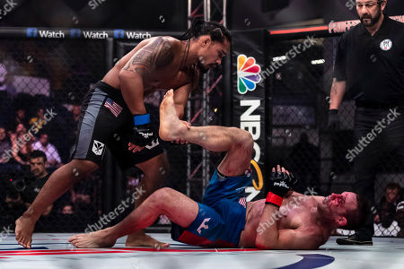 Jake Shields and Ray Cooper III in action during their welterweight fight at the Charles E. Smith Center at George Washington University in Washington, District of Columbia. Cooper defeated Shields by TKO
