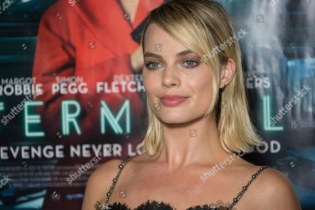 Margot Robbie poses for photographers upon arrival at the UK premiere of Terminal in central London