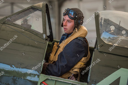 Pilot Officer Ben Davidson in period dress with a Spitfire Mk16 A variant of the iconic Battle of Britain fighter - RAF 100, Horse Guards Parade. As part of the 100th Anniversary celebrations of the Royal Air Force, an exhibition of aircraft covering the RAF's history, from WW1 and WW2 through to the modern age.