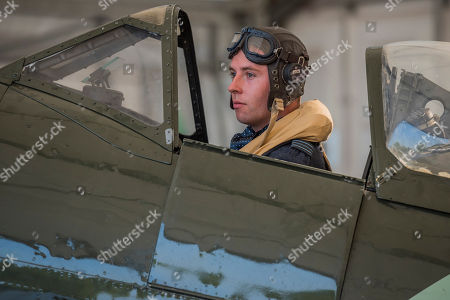 Stock Image of Pilot Officer Ben Davidson in period dress with a Spitfire Mk16 A variant of the iconic Battle of Britain fighter - RAF 100, Horse Guards Parade. As part of the 100th Anniversary celebrations of the Royal Air Force, an exhibition of aircraft covering the RAF's history, from WW1 and WW2 through to the modern age.