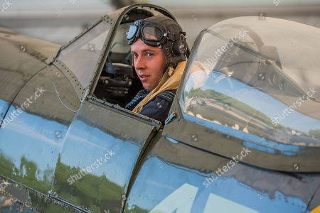 Stock Photo of Pilot Officer Ben Davidson in period dress with a Spitfire Mk16 A variant of the iconic Battle of Britain fighter - RAF 100, Horse Guards Parade. As part of the 100th Anniversary celebrations of the Royal Air Force, an exhibition of aircraft covering the RAF's history, from WW1 and WW2 through to the modern age.