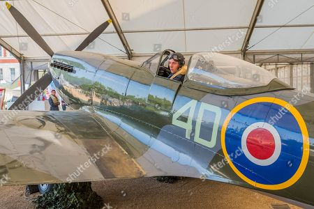 Stock Picture of Pilot Officer Ben Davidson in period dress with a Spitfire Mk16 A variant of the iconic Battle of Britain fighter - RAF 100, Horse Guards Parade. As part of the 100th Anniversary celebrations of the Royal Air Force, an exhibition of aircraft covering the RAF's history, from WW1 and WW2 through to the modern age.