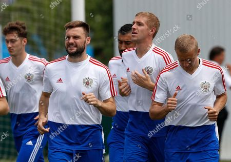 Russia's Vladimir Granat, second left, takes part with teammates during Russia official training at the 2018 soccer World Cup at Park Arena in Sochi, Russia, on the eve of the quarter-final match between Russia and Croatia at the 2018 soccer World Cup