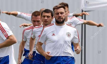 Russia's Vladimir Granat, front, exercises with teammates during Russia official training at the 2018 soccer World Cup at Park Arena in Sochi, Russia, on the eve of the quarter-final match between Russia and Croatia at the 2018 soccer World Cup