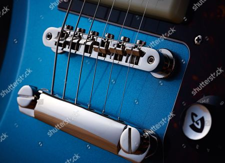 Detail Of The Bridge And Stud Tailpiece On A Guild T-bird St P90 Electric Guitar With A Pelham Blue Finish